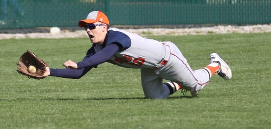 Galion's Carter Keinath makes a diving catch during a 7-5 win over Clear Fork on Tuesday night.