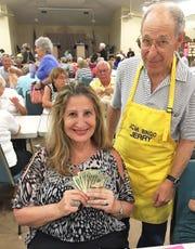 Big winner Angela Vomero with Bingo community member Jerry Levin.