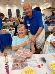 On Thursday, April 11, the Knights of Columbus San Marco Council #6344 hosted a Bingo night in the San Marco Parish Center. Above: Grand Knight Joe Swaja giving the cash to jackpot winner Judy Evanko of New Jersey.