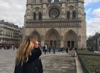 A Wauwatosa native joined many others in Paris in singing outside the Notre Dame cathedral after a devastating fire Monday.