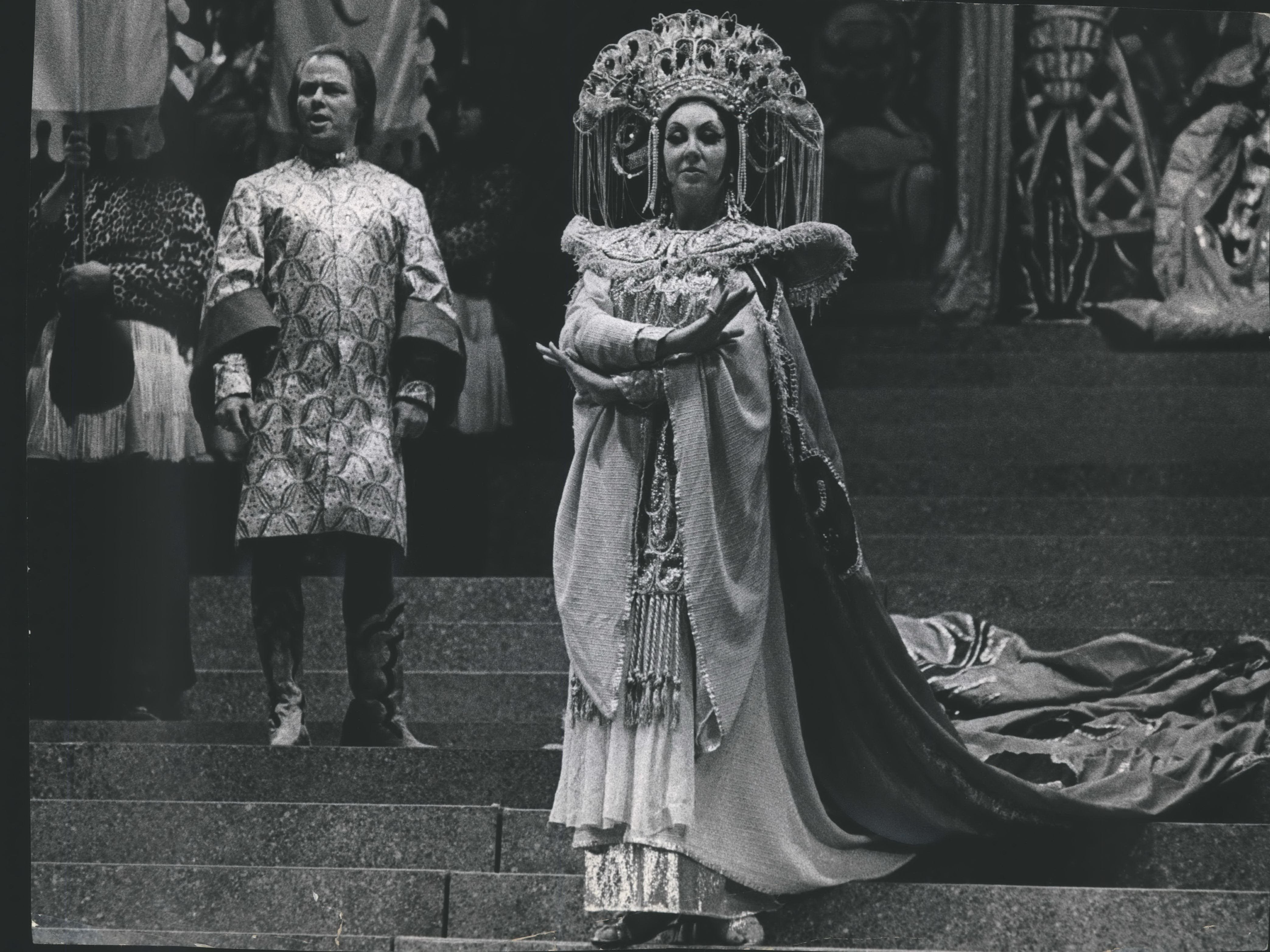 "The Florentine Opera Company opened its 40th season in 1971 with ""Turandot."" Dramatic soprano Marion Lippert of the Metropolitan Opera Company sang the title role. With her in this scene from the opera is Michele Molese, a New York Center Opera tenor, who sang the role of Calaf."