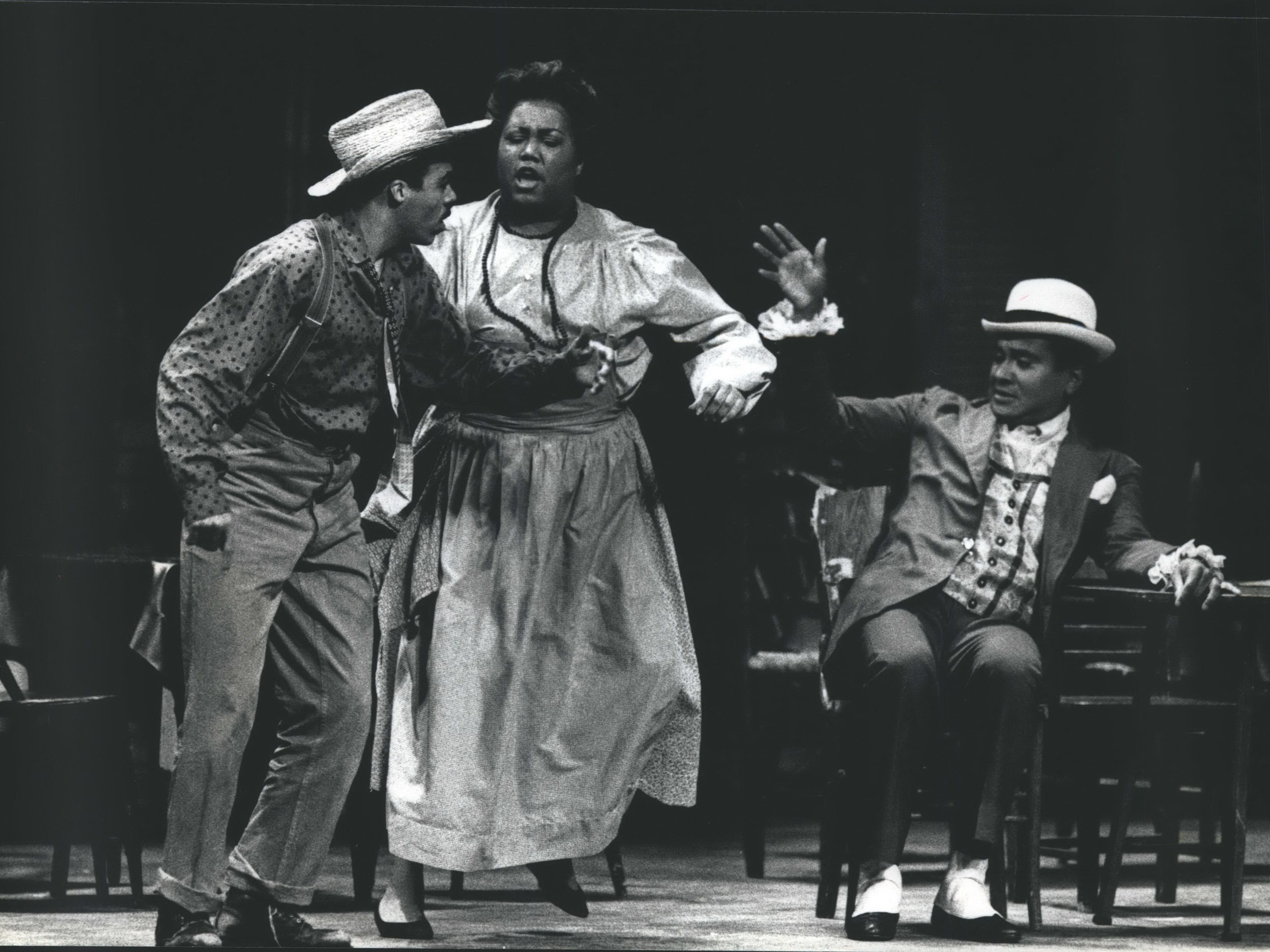 "Catfish Row, a black tenement on the waterfront of Charleston, S.C., comes to life in this scene from the Florentine Opera's ""Porgy and Bess,"" 1989."