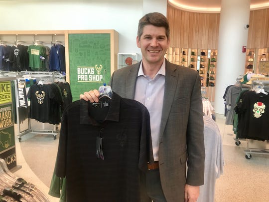 Matt Schmaling picks out a new shirt to wear to watch the Bucks in the NBA playoffs