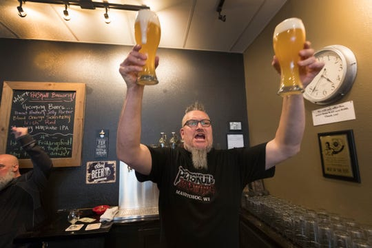 "Co-owner Paul Hoffman yells out ""Schnitzky"" after a customer orders a glass of the German hefeweizen called Schnitzky. It's part of the ambiance at PetSkull Brewing in Manitowoc."