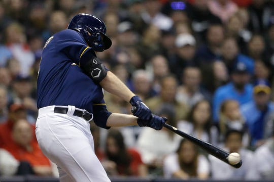 Brewers pitcher Brandon Woodruff hits a two-run double in the third inning Tuesday night.