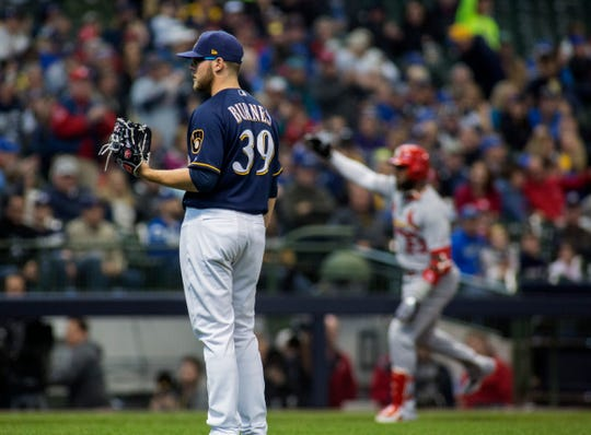 Brewers starter Corbin Burnes gives up a home run to the Cardinals' Marcell Ozuna during the second inning Wednesday at Miller Park.