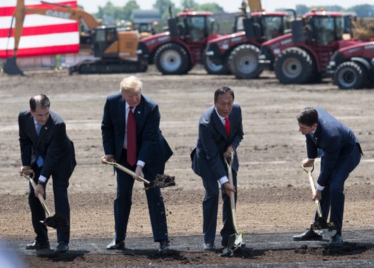 President Donald Trump (second from left) is joined by Gov. Scott Walker (left), Foxconn Chairman Tery Gou and House Speaker Paul Ryan (right) June 28, 2018, during the ceremonial groundbreaking for Foxconn's factory in Mount Pleasant.