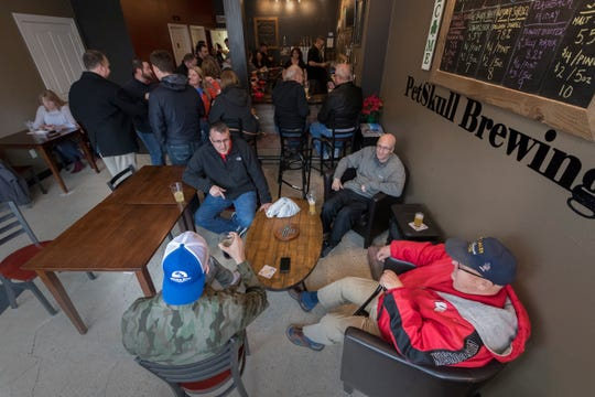 PetSkull Brewing customers use the brewery like a community center. They get together for beers, popcorn and general conversation.