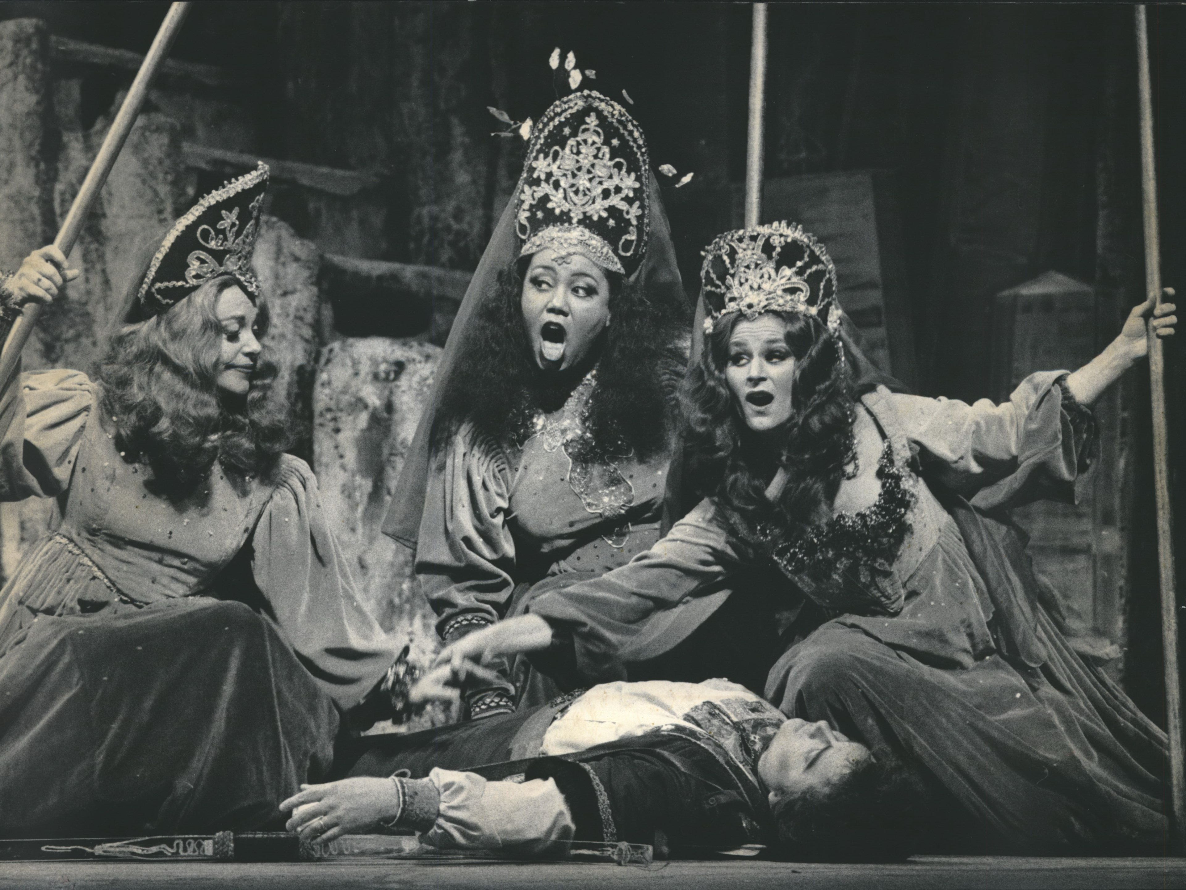 "Marjorie Fowler (from left), Anita Berry and Patrice Michaels Bedi compete over the unconscious Donald Kaasch as Tamino, Prince of Egypt, in the first act of ""The Magic Flute."" The Florentine Opera performed the classic Mozart opera in 1990."