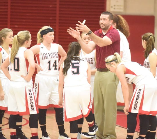 Norfork coach Josh Laymon instructs players during a timeout in a game this season at the North Arkansas College tournament.