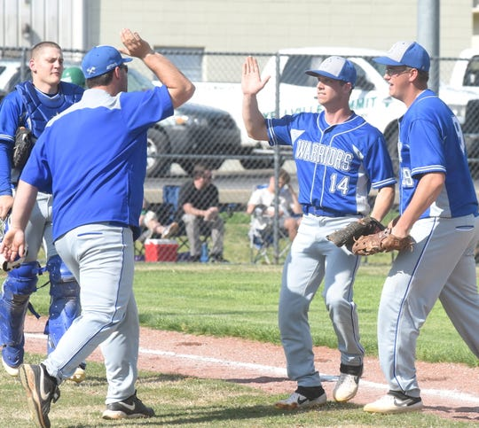 Cotter pitcher Kevin Walker is congratulated by coach Jarod Jefferson after retiring the side against Yellville-Summit on Tuesday.