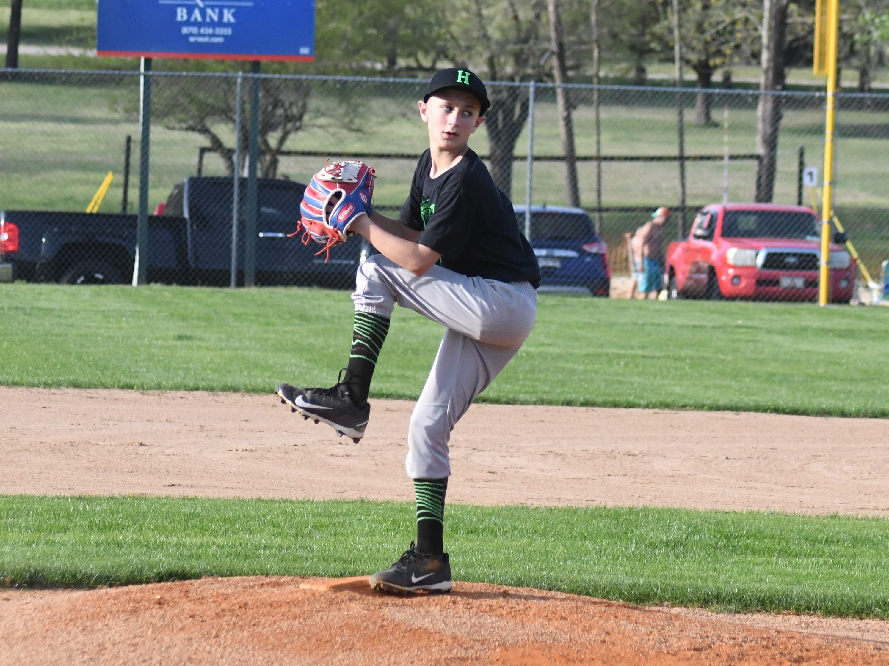 Jordan Corbett pitches for the Holy Smoke team during their game at NEXT Powered by NAEC Field on Tuesday evening.