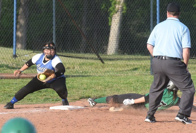 Yellville-Summit's Abby Brantner slides safely into third base as Cotter's Ashley Garay attempts to make the tag Tuesday night.