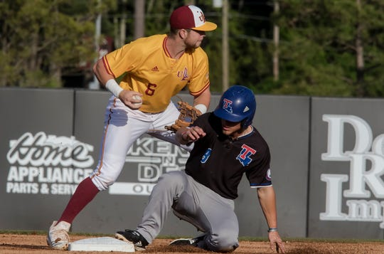 University of Louisiana at Monroe's Mason Prososki (6) looks to make the throw to first base after making the out against Louisiana Tech's Taylor Young (8) during the game at Warhawk Field on April 16. Tech would blank ULM 5-0.