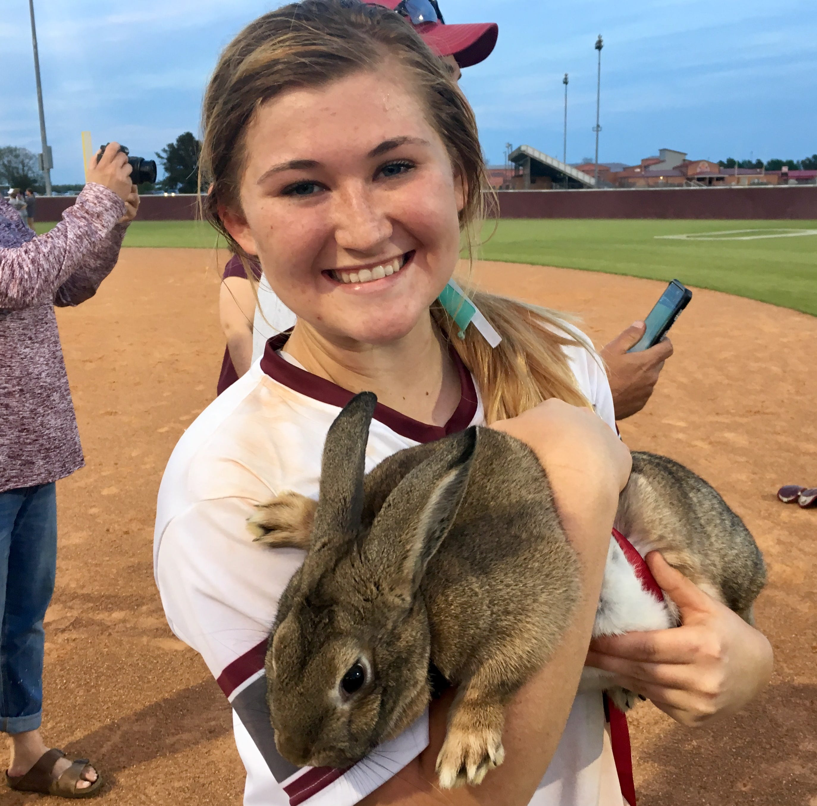 "Madelynn Fletcher celebrates her walk off double with the Lady Lions's unofficial mascot ""Bonnie the Bunny"" after Ouachita's 4-3 victory over Hahnville."