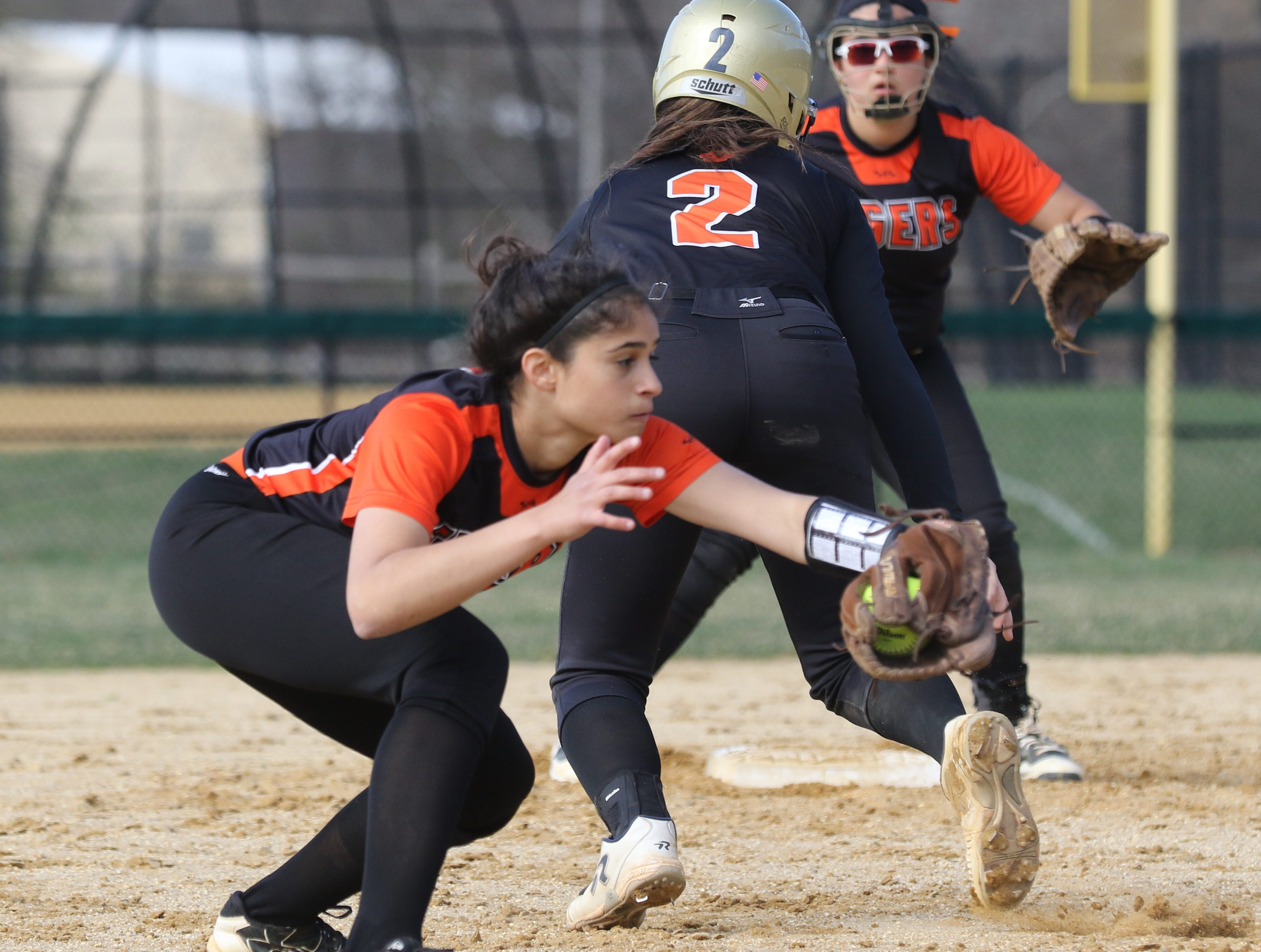 Hackettstown shortstop Alivia Duran gets the throw but can't get Alison Koo of Dover out as she gets back to second base.