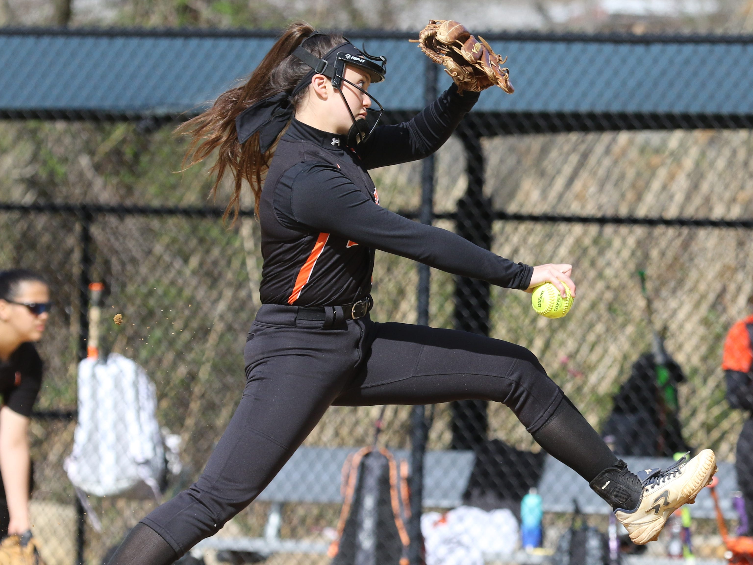 Dover pitcher Alison Koo delivers the ball in the first inning.