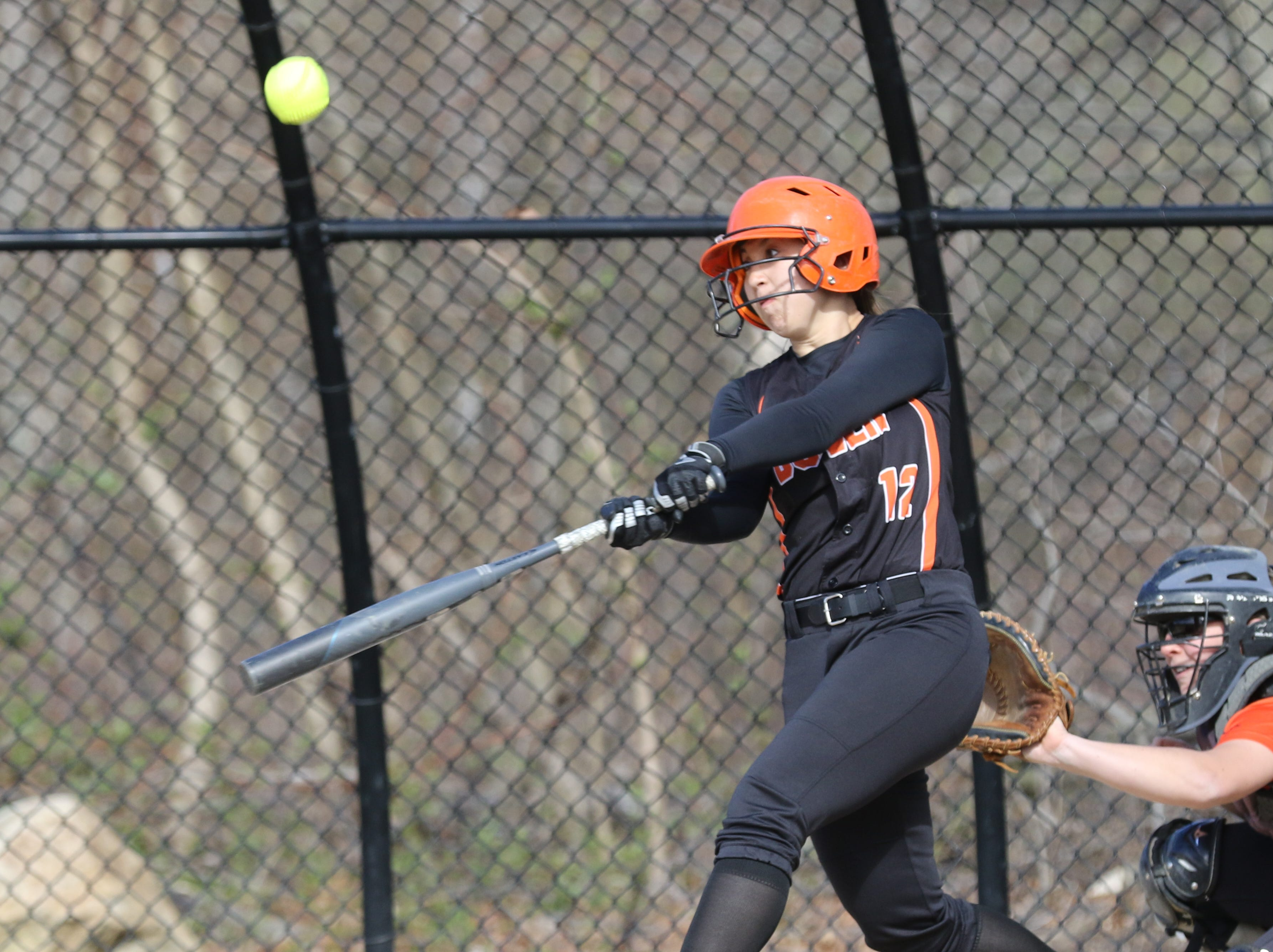 Brianna Koo of Dover hits the ball in the first inning.