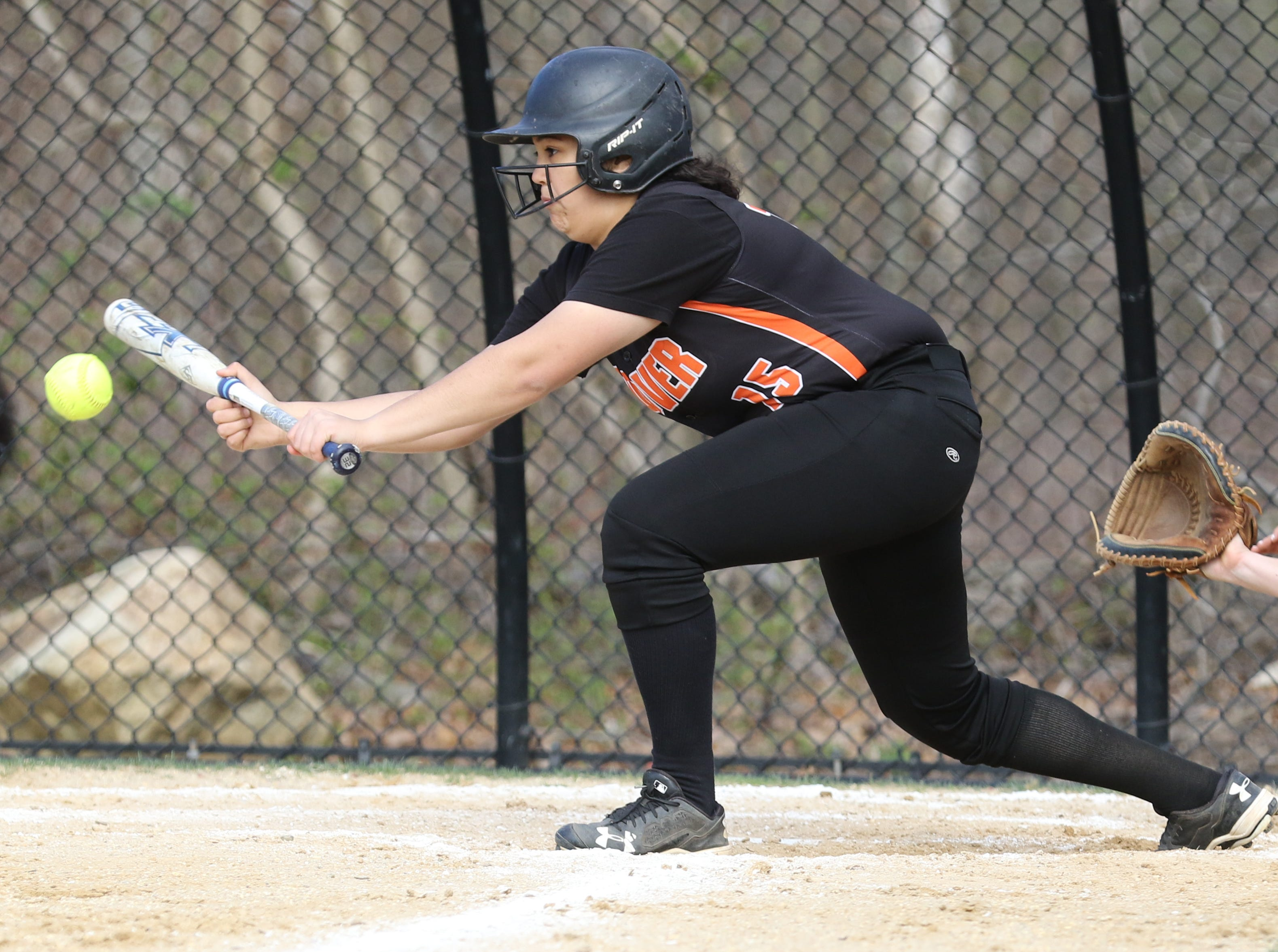 Nour El-Sayyid of Dover bunts the ball in the second inning.