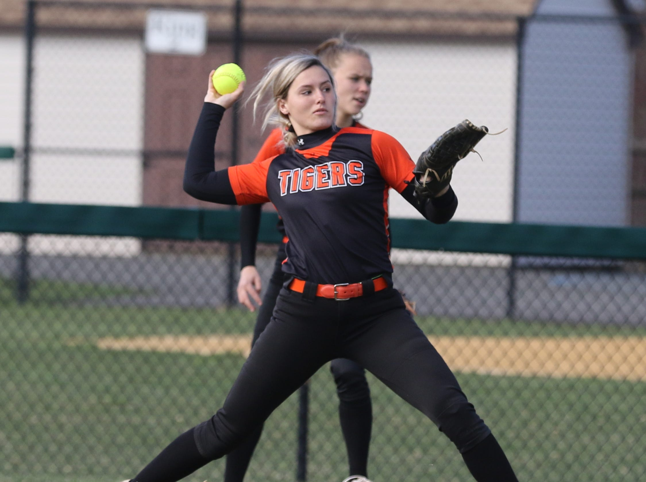 Hackettstown centerfielder Molly O'Brien makes this throw after making a catch to get a double play at first base.