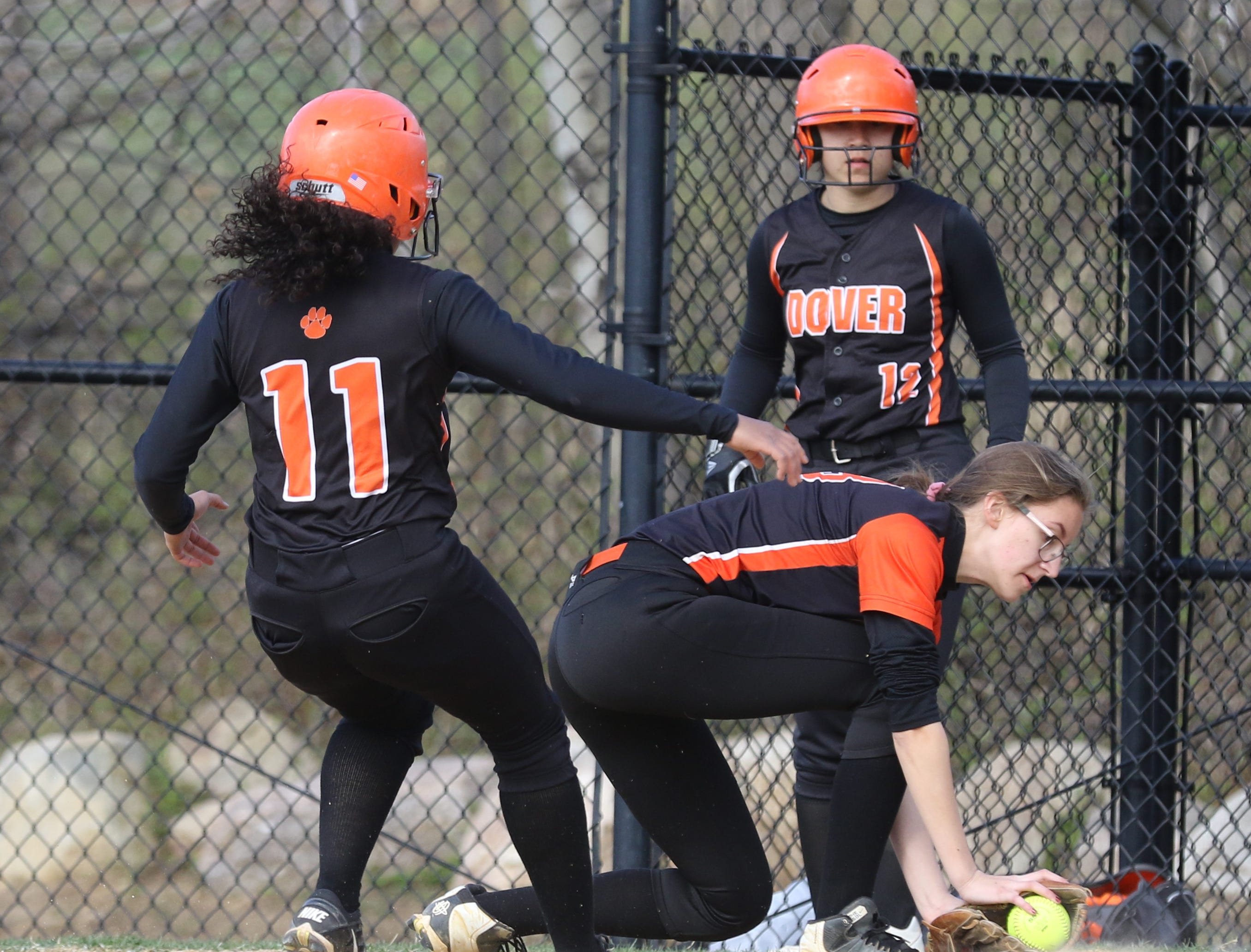Chelsea Estacio of Dover can't back to first base in time to get caught in a double play as Hackettstown first baseman Katie Vreeland picks up the ball to make the out.