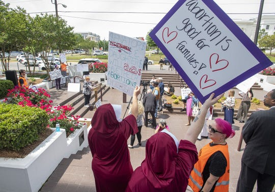 A protest is held against HB314 at the Alabama Statehouse in Montgomery, Ala., on Wednesday April 17, 2019.