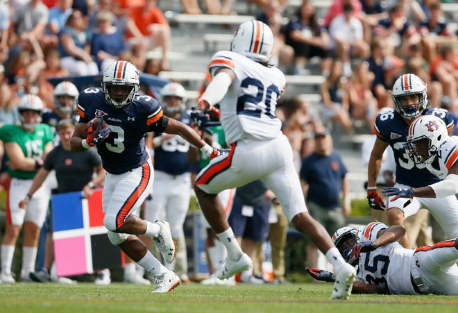 Auburn running back D.J. Williams (3) carries during the A-Day game at Jordan-Hare Stadium on April 13, 2019.