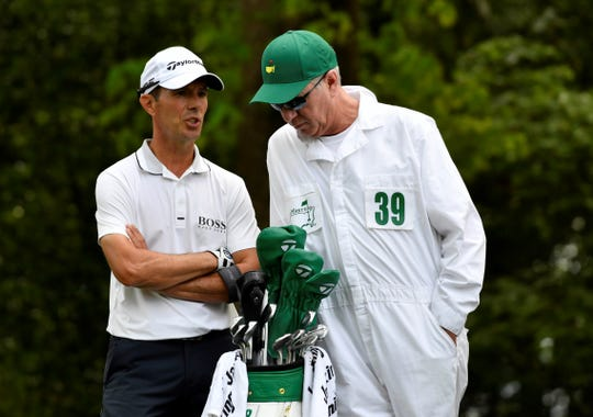 Apr 11, 2019; Augusta, GA, USA; Mike Weir with caddie Graeme Courts on the 2nd tee during the first round of The Masters golf tournament at Augusta National Golf Club. Mandatory Credit: Michael Madrid-USA TODAY Sports