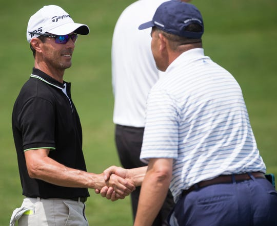 Mike Weir greets fellow golfers in his pairing during the Robert Trent Jones Championship Pro Am at the Capitol Hill Golf Course in Prattville, Ala., on Wednesday, April 17, 2019.