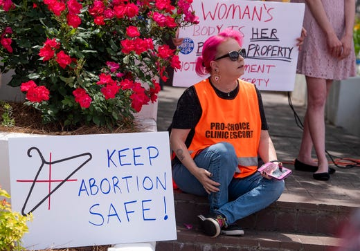 Mia Raven looks on as protest is held against HB314, the abortion ban bill, at the Alabama Statehouse in Montgomery, Ala., on Wednesday April 17, 2019.