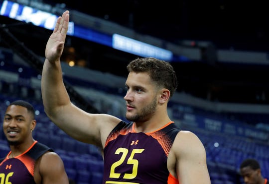 Mar 3, 2019; Indianapolis, IN, USA; Ohio State defensive lineman Nick Bosa (DL25) gives a high five after finishing his workout drills during the 2019 NFL Combine at Lucas Oil Stadium. Mandatory Credit: Brian Spurlock-USA TODAY Sports