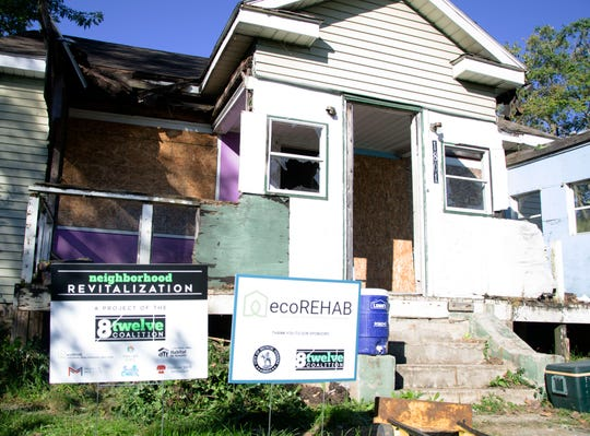 Cleanup efforts begin for the rehabilitation of 1801 S. Jefferson St., the latest in ecoREHAB's project list. It's the seventh home the group has helped rehabilitate.
