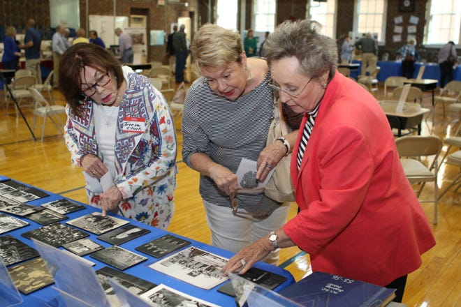 From left, Teresa J. Clark-Owens, Marylou Turpin, Linda Dansby look at historical photos related to Homer Pittard Campus School. The teaching laboratory school owned by MTSU and operated by Rutherford County Schools, held its 90th anniversary celebration Tuesday, April 16, at the school's East Lytle Street campus.