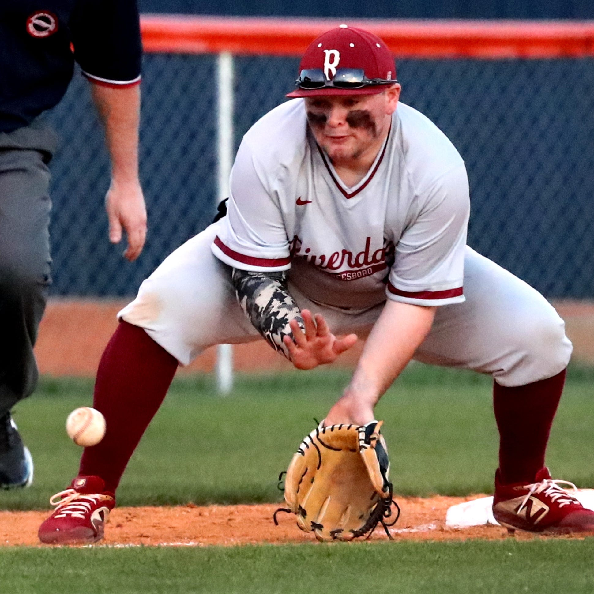Riverdale's third baseman Johnny Powers (10) fields the ball and tires to out the Blackman runner on third base on Tuesday April 16, 2019.