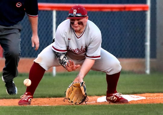 Riverdale third baseman Johnny Powers fields the ball against Blackman on Tuesday.