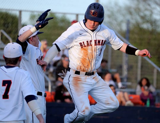 Blackman's Conner Murphy (1) celebrates scoring a run against Riverdale on Tuesday April 16, 2019.