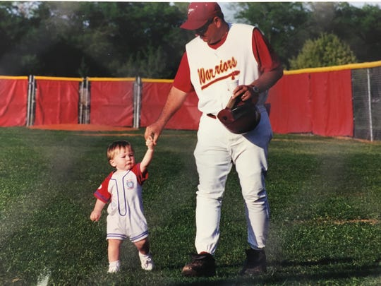 Former Riverdale baseball coach Buddy Powers (right) walks with his son, Johnny, prior to a game in the early 2000s. Johnny is now a senior at Riverdale.
