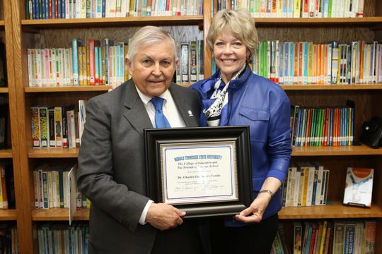 From left, Charles and Delia Goodman hold a special certificate of recognition in honor of their family's long history of association with Homer Pittard Campus School. The teaching laboratory school owned by MTSU and operated by Rutherford County Schools, held its 90th anniversary celebration Tuesday, April 16, at the school's East Lytle Street campus.