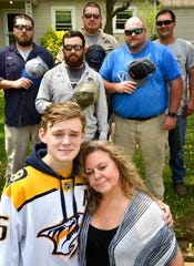 Tricia Bassow, with her son, Wyatt, beside her, wanted to say thanks to five Nashville Electric Service workers — Jeremy Pilkerton, Zack Miller, John Harris, Trent McCormack and Thomas Patt — who tried to save her husband with CPR on April 11. Tricia was moved when the lineman took off their hard hats and put them over their hearts while her husband was loaded into the ambulance. Wednesday, April 17, 2019, in Nashville, Tenn.