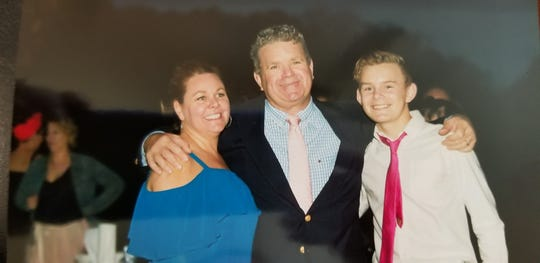 Tricia and Michael Bassow with their son, Wyatt, 14, at a wedding in October last year.