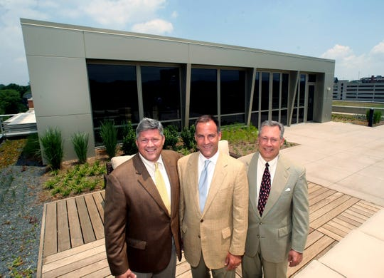 Bill Freeman, co-founder, left, Kent Burns, president, and Jimmy Webb, co-founder, stand together on the green roof at the new Freeman Webb building during an open house June 23, 2009. This is the first GOLD LEED pre-certified building in Tennessee.