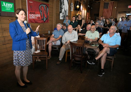 U.S. Sen. Amy Klobuchar speaks to people at Edley's Bar-B-Que in Nashville on Wednesday, April 17, 2019.