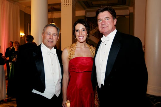 Jimmy Webb, left, Rachel Odom and Gary Odom are sharing a moment during the Symphony Ball Dec. 13, 2008.