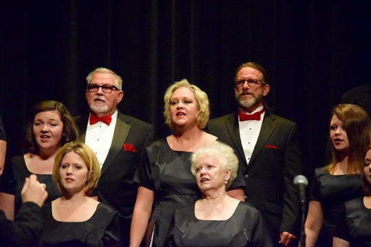 Members of the Dickson Community Chamber Choir perform.