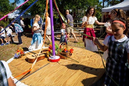 Students dance around the maypole during a medieval fair organized by eighth graders at the Village School of Naples on Wednesday, April 17, 2019.