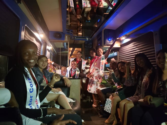 Immokalee High School seniors and Guadalupe Center Tutor Corps graduates board a bus back to Immokalee following a celebration dinner and scholarship award ceremony Tuesday, April 16, 2019, at Grey Oaks Country Club.