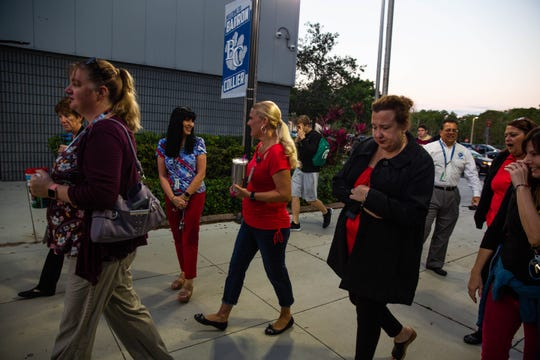 "Teachers at Barron Collier High School in North Naples participate in the statewide ""walk-in"" to support increased funding for public schools on Wednesday, April 17, 2019."
