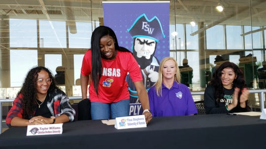 FSW basketball player Tina Stephens reveals her choice to play for Kansas next season during a signing ceremony on Wednesday, April 17, 2019. Stephens picked the Jayhawks over Oklahoma State and Pitt.