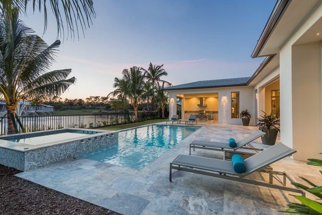The Bianca model features an outdoor living area with a custom pool with a sun shelf and spa.
