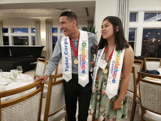 Immokalee High School seniors and Guadalupe Center Tutor Corps graduates Gabriel Ramirez and Evelyn Franco laugh while talking to friends after a celebration dinner honoring the accomplishments of Tutor Corps students on Tuesday, April 16, 2019, at Grey Oaks Country Club. Gabriel asked Evelyn to prom when the event ended.